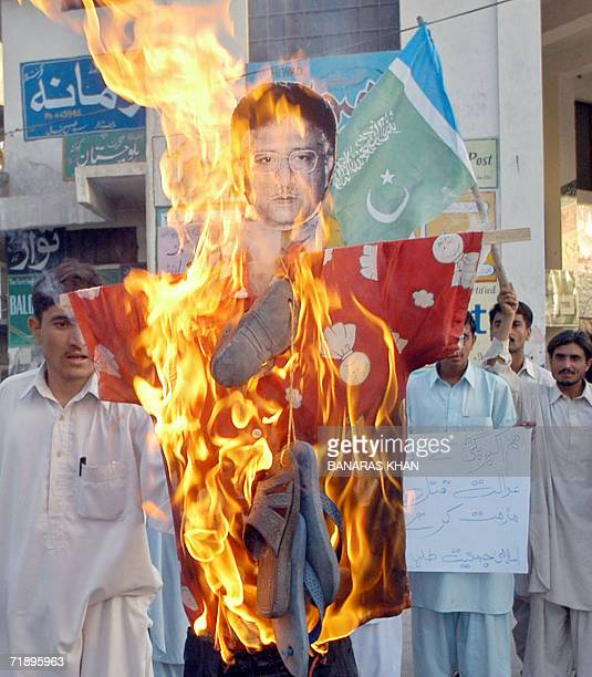 Pakistani activists from JamaateIslami torch an effigy of President Pervez Musharraf during a protest against the killing of rebel tribal chief Nawab...