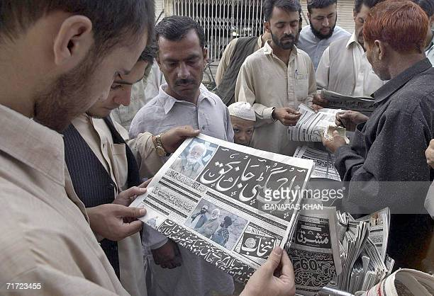 Pakistani men read newspapers with the news of the death of tribal rebel chieftain Nawab Akbar Bugti on the front pages at a roadside stall in Quetta...