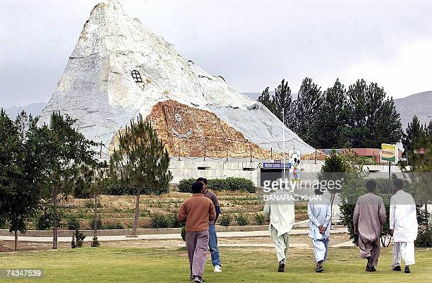 Pakistani people visit a replica of the Chagai Mountain where Pakistan test fired their first nuclear weapon in 1998 in Quetta 28 May 2007 disgraced...