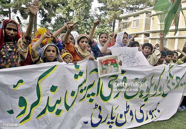 Pakistani supporters of the Jamhoori Watan Party carry a portrat of rebel tribal chief Nawab Akbar Bugti as they shout slogans and protest against...
