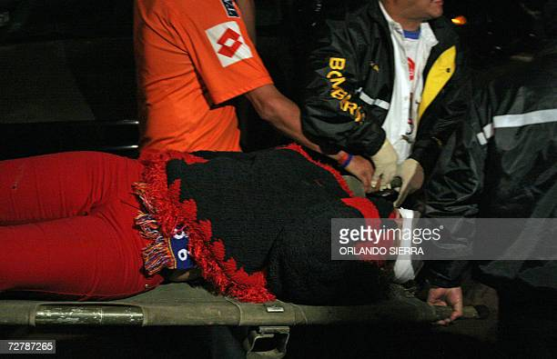 A woman is being evacuated at the Mario Camposeco stadium in Quetzaltenango City 09 December 2006 Supporters were injured during a match between...