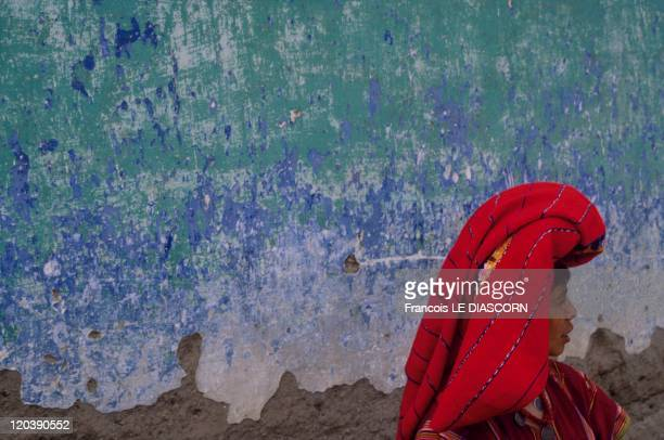 Quetzaltenango Guatemala Woman in red against a blue wall Zunil