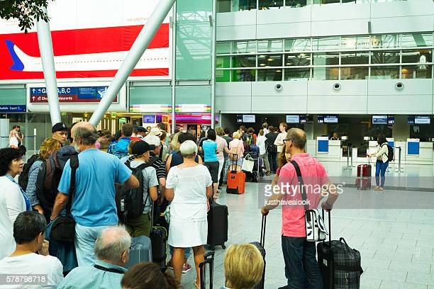 Queue at economy class check-in