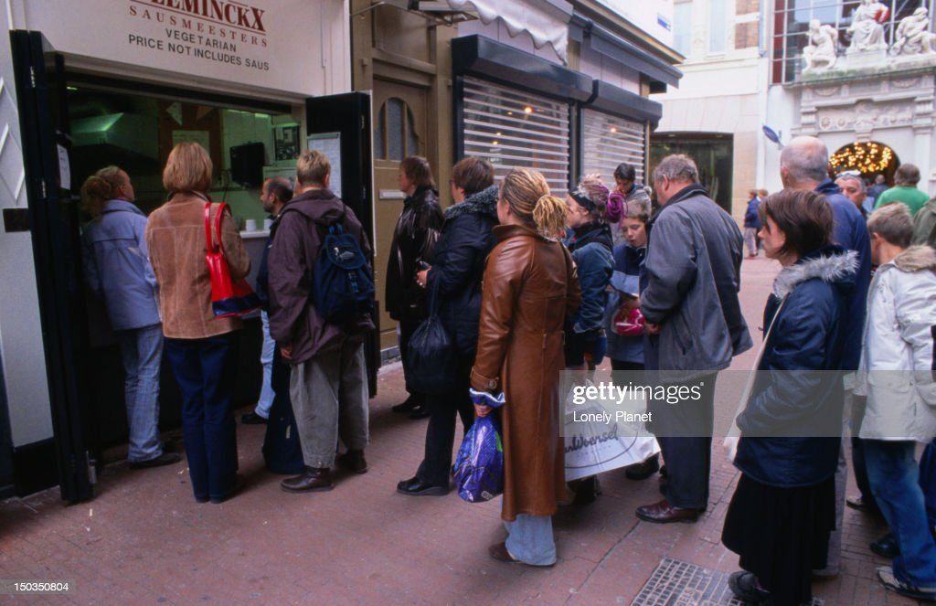 Queue at Vlaams Fritehuis fries and mayonnaise shop on Voetboogstraat. : Stock Photo