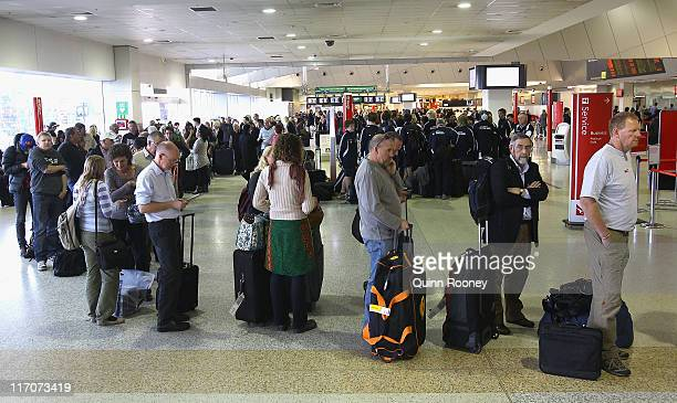 A queue forms at the Qantas Terminal as airlines cancel flights due to volcanic ash at Melbourne Domestic Airport on June 21 2011 in Melbourne...