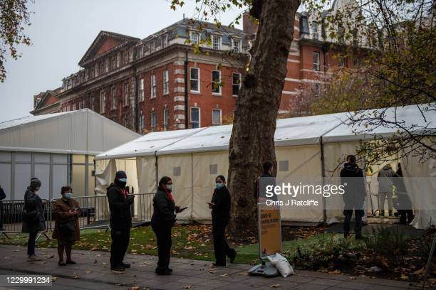 Queue forms outside a Covid-19 testing centre in a temporary structure at Kings College in England on December 7, 2020 in London, United Kingdom....