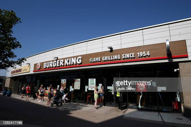 Queue is seen outside a Burger King restaurant on June 25, 2020 in New Brighton, United Kingdom.
