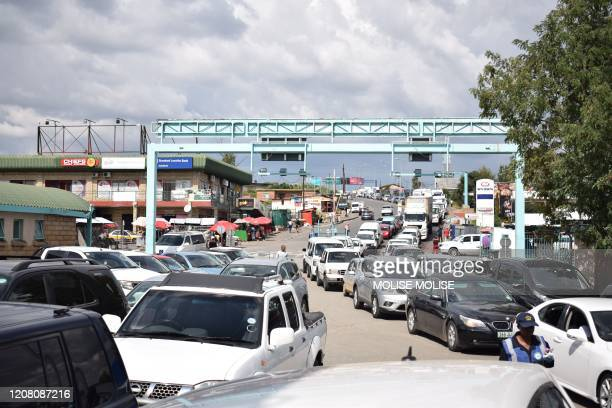 A queue of cars are seen at the Maseru Bridge border post between Lesotho and South Africa on March 24 as residents and retailers of Lesotho head to...