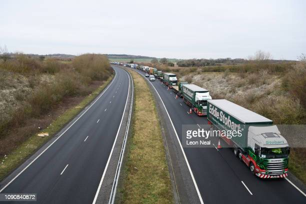 A queue of hired haulage trucks are seen on the A256 as the Government carries out tests on the road infrastructure to find an optimal release rate...