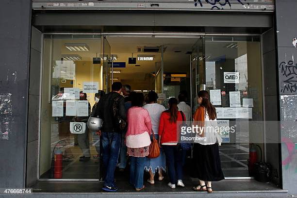 A queue of jobseekers enter a job center shortly after opening in Athens Greece on Thursday June 11 2015 European Union President Donald Tusk accused...