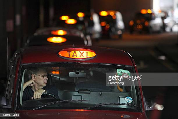 A queue of London taxis have their lights on showing they are available for a fare in London UK on Friday May 4 2012 Olympic tourists seeking to hire...