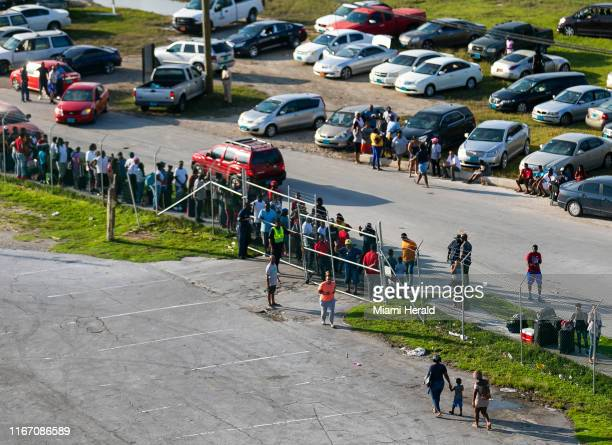 A queue of more than 100 people wait outside of the Freeport Cruise Port in Grand Bahamas on Friday September 6 2019 Some Bahamians await the arrival...