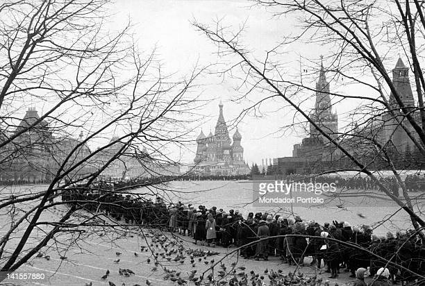 A queue of people forms waiting to enter the Lenin mausoleum in Red Square Moscow January 1960