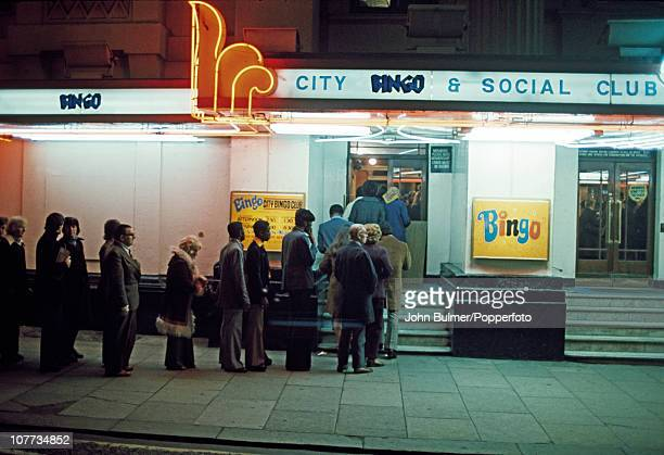 A queue of people outside the City Bingo and Social Club formerly the Theatre Royal in Manchester England in 1976