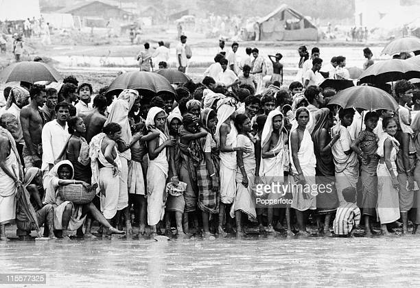 Queue of refugees waiting for food and medicines at a camp near Calcutta, India on 8th June 1971. .