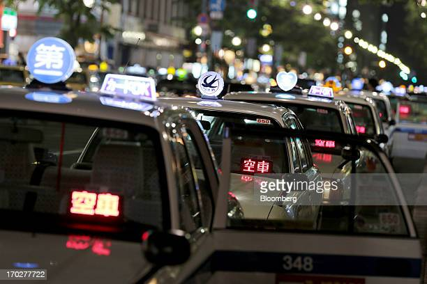 A queue of taxis have their lights on showing they are available for a fare in Sapporo Hokkaido Prefecture Japan on Sunday June 9 2013 Japans economy...