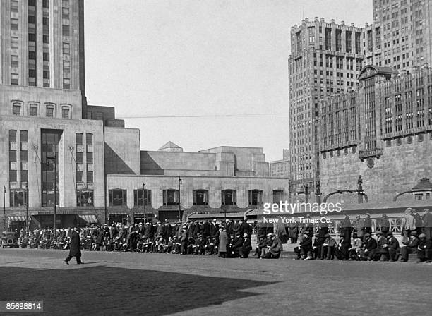 A queue of unemployed men on Canal Street and Madison Street Chicago waiting to call at an employment agency 1932