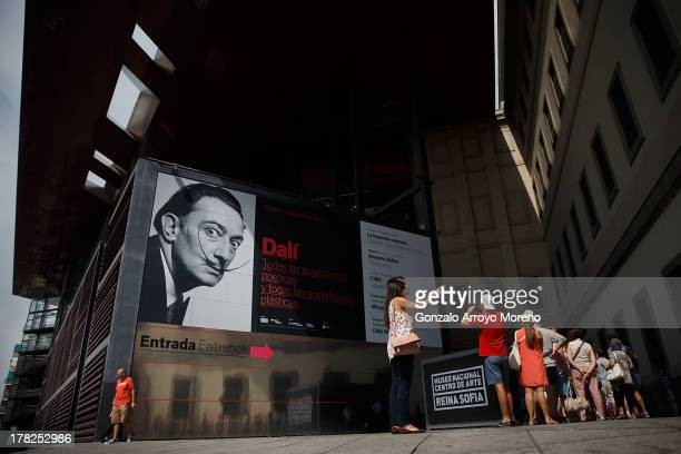A queue of visitors wait for a Salvador Dali temporary exhibition at Reina Sofia Art Museum extension building designed by the wellknown architect...