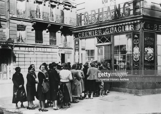 Queue of women outside a dairy shop in Germanoccupied Paris 28 June 1940 Shortages and rationing were part of everyday life for Parisians during the...