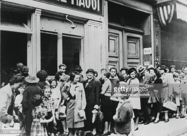 Queue of women outside a dairy shop, in German-occupied Paris, 28 June 1940. Shortages and rationing were part of everyday life for Parisians during...