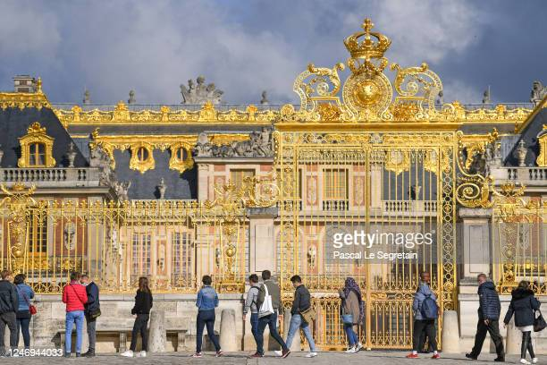 Queue outside one of the entrances to Chateau de Versailles as the palace is reopened to the public since its closure on March 13, 2020 due to...