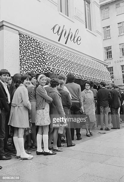 A queue outside the Apple boutique run by the Beatles' Apple Corps on the day of its closing when all its remaining stock was given away London 31st...