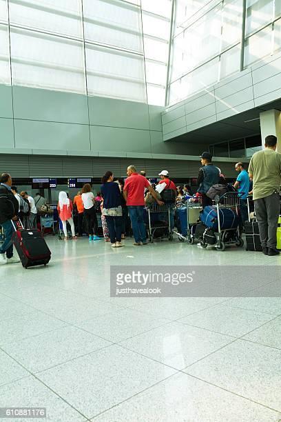 Queued passengers in airport