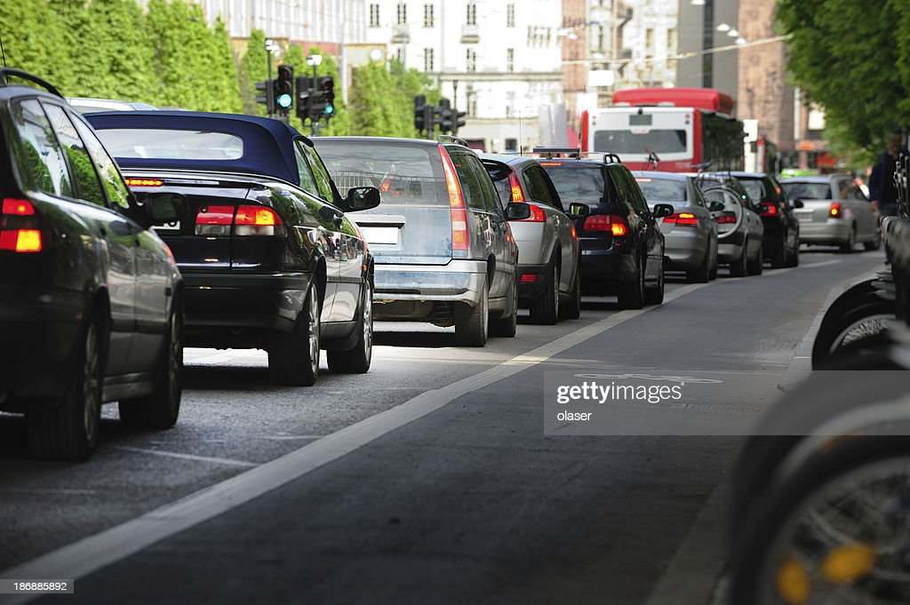 Queueing cars in the city : Stock Photo