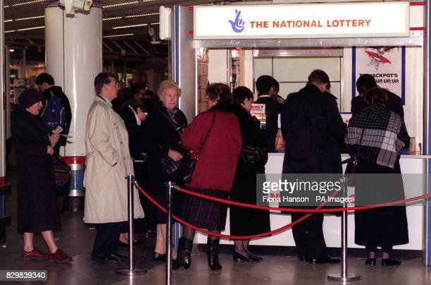 Queues at the National Lottery stand in London's Liverpool Street Station this afternoon Camelot the lottery operators today indicated thast this...