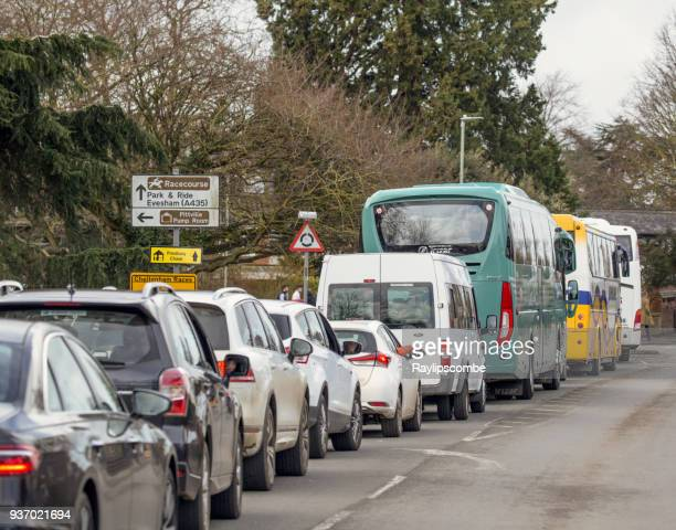 queues of cars and racegoers on their way to the world famous cheltenham national hunt festival horse races - bank holiday stock photos and pictures