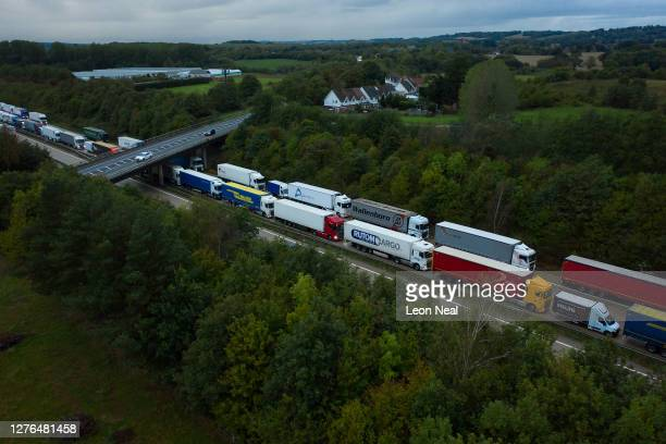 Queues of heavy goods vehicles and cargo lorries are seen queued along the M20 motorway as part of the Operation Stack traffic control plan on...