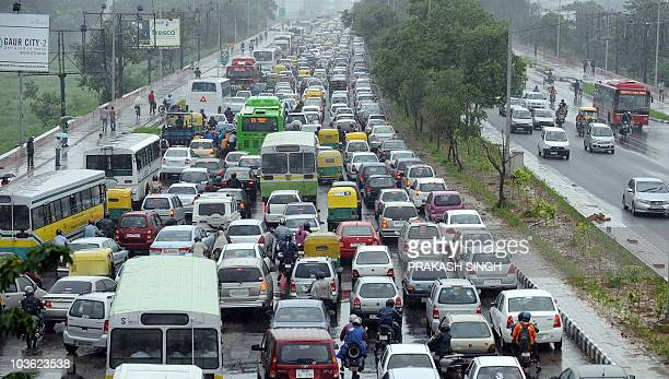 Queues of vehicles jam a road during heavy rain in New Delhi on August 25 2010 Heavy and continuous rainfall over the weekend left the Indian...