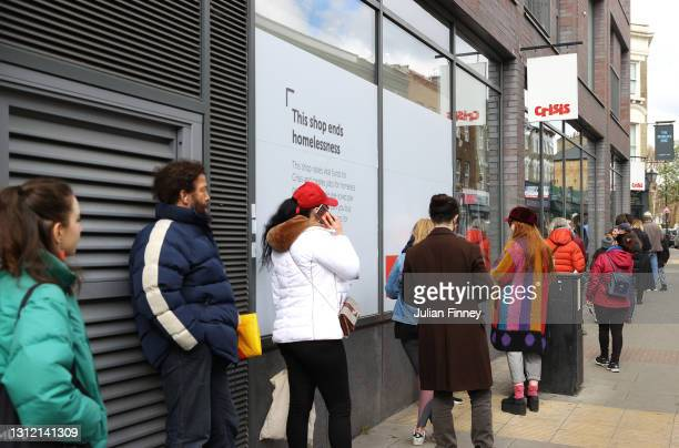 Queues outside Crisis charity shop as it re-opens on April 12, 2021 in London, United Kingdom. England has taken a significant step in easing its...