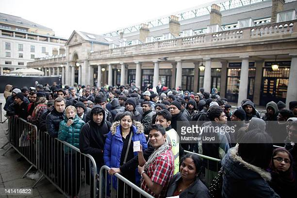 Queues wait outside the Apple Store in Covent Garden to buy the new iPad on March 16 2012 in London England The new iPad 3 goes on sale today with...