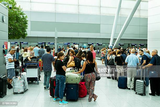Queues with passengers at check-in