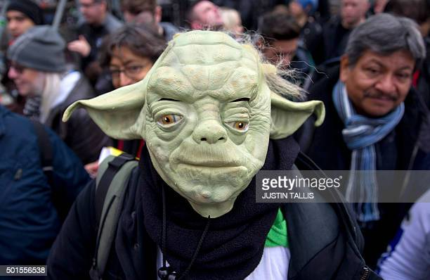 A queuing fan wearing a Yoda mask poses ahead of the European Premiere of 'Star Wars The Force Awakens' in central London on December 16 2015 Ever...