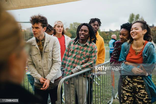 queuing for a music festival - lining up stock pictures, royalty-free photos & images