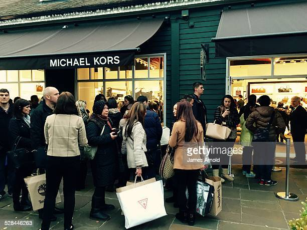 Queuing to get into Michael Kors Black Friday at Bicester Village designer outlet shopping centre Oxfordshire UK Friday 28 November 2014