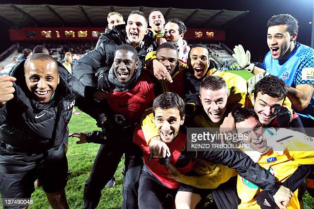Quevilly's football team celebrates after winning the French Cup football match Le Petit-Quevilly versus Angers, on January 21, 2012 at the Stade...