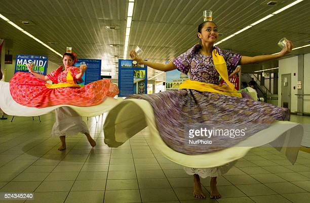 Quezon City PhilippinesJanuary 20 2014 Flash mob performed folk dance at the Light Rail Transit station in Cubao It is a teaser to the Philippine...