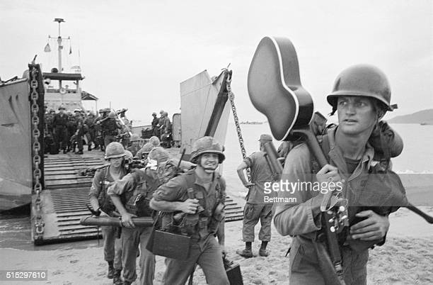 9/13/1965 Qui Nhon South Vietnam Guitar slung over his shoulder a trooper of the United States 1st Calvalry walks ashore from a landing craft More...