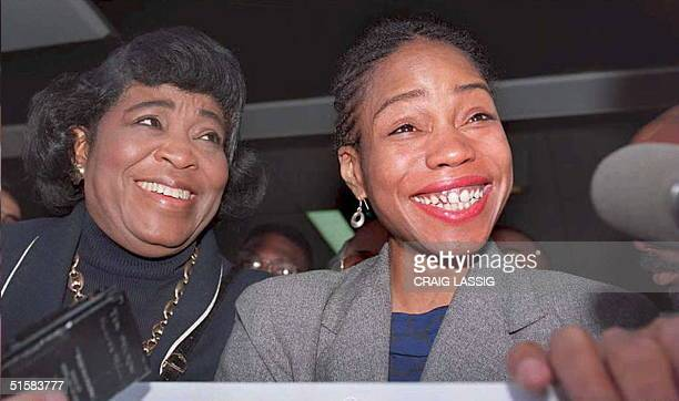 Quibilah Shabazz daughter of Malcolm X smiles at a new conference 01 May after it was announced that she had reached an out of court settlement with...