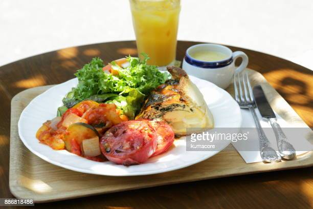 Quiche in plate with orange juice