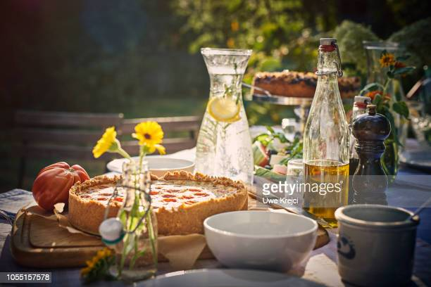 Quiche on table in garden, close up