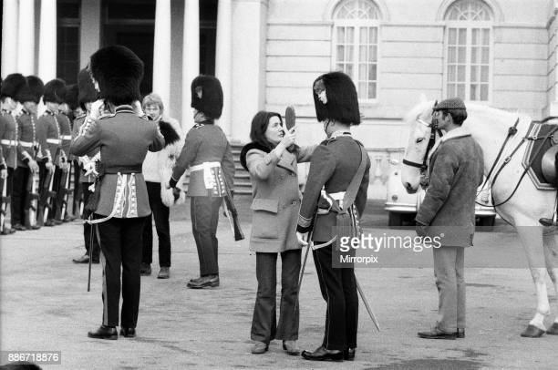 Quick brush for one of the officers during the filming of 'The Breaking of Bumbo' at Pinewood Studios, 10th March 1970.