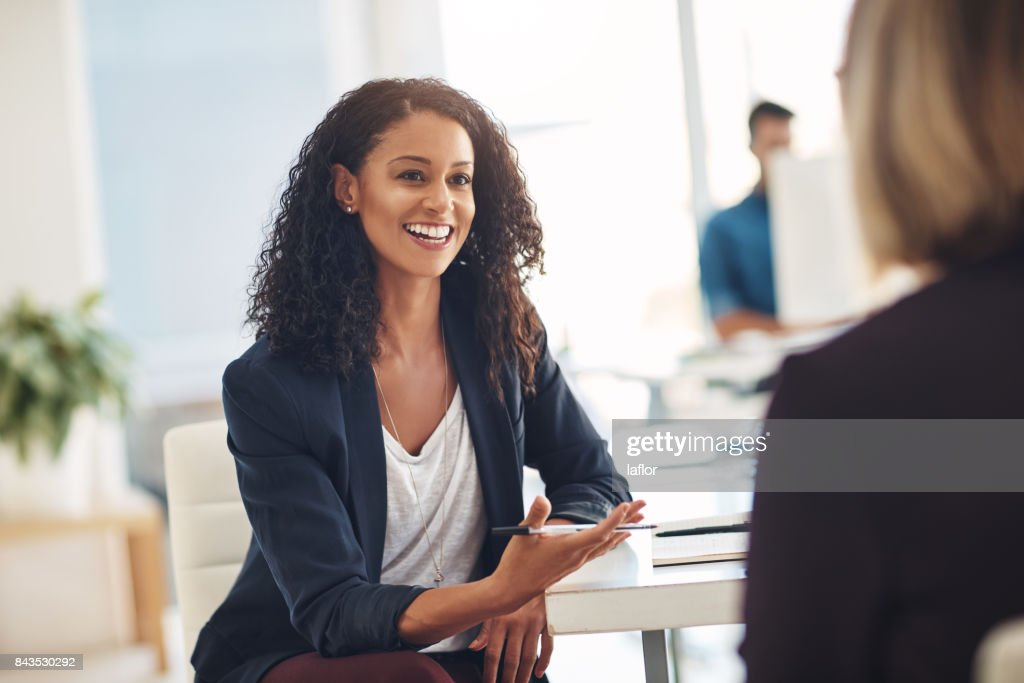 Quick catch up with a coworker : Stock Photo