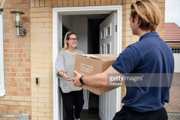 quick delivery - passing giving stock pictures, royalty-free photos & images