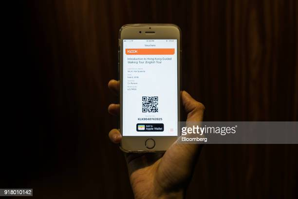 A quick response code is displayed on a digital voucher for a guided walking tour hosted by Klook Travel Technology Ltd in an arranged photograph...