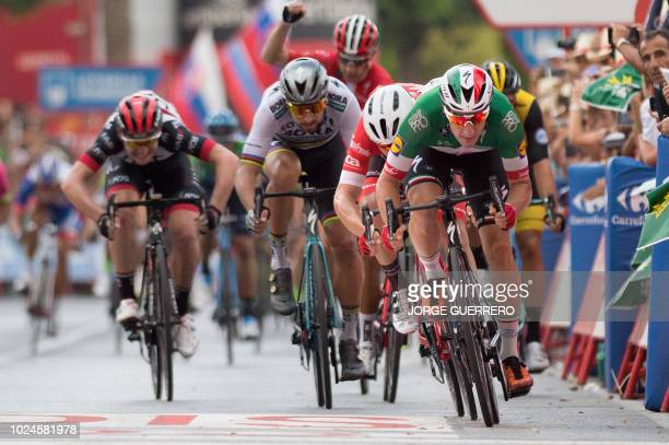 """Quick - Step Floors' Italian cyclist Elia Viviani crosses the finish line winning the third stage of the 73rd edition of """"La Vuelta"""" Tour of Spain..."""