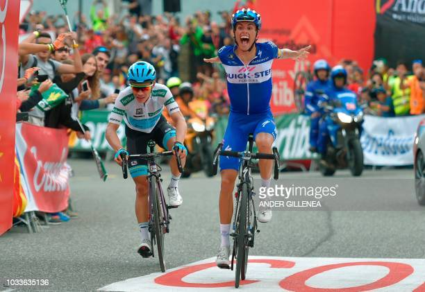 Quick Step Floors' Spanish cyclist Enric Mas celebrates next to Team Astana's Colombian cyclist Miguel Angel Lopez as he wins the 20th stage of the...